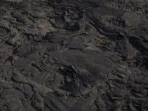 Modelli della lava vicino al vulcano della birra inglese di Erta, Etiopia Fotografia Stock