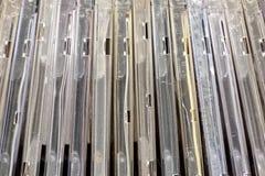 Modelli e strutture verticali dei supporti dei dischi compatti Immagini Stock