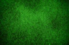 Modelli il fondo dipinto nel verde con il fuoco molle Fondo per Immagini Stock