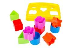 Modelli il giocattolo del selezionatore con i vari blocchi colorati isolati Fotografie Stock Libere da Diritti