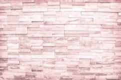 Modelli marrone chiaro dell'estratto della parete di pietra per struttura o fondo fotografia stock libera da diritti
