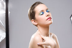 Modelling for beauty shot in studio. Stock Image