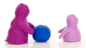 Modelling clay figures with a ball Stock Photos