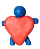 Modelling clay man holding heart Royalty Free Stock Photography