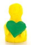 Modellistica della figura dell'argilla con un cuore Fotografia Stock