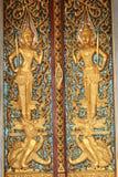 Modello antico di arte sulla porta di legno in tempio tailandese Immagine Stock Libera da Diritti