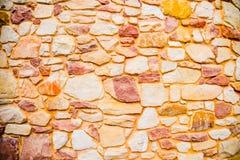 Modello arancio della parete di pietra Immagine Stock Libera da Diritti