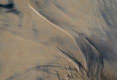 Modello astratto sulla sabbia della spiaggia fotografie stock