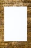 Modello bianco per un testo su un pavimento di legno Immagini Stock