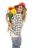 Modello biondo allegro con un mazzo dei fiori 3 Immagini Stock