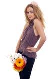 Modello biondo sexy con un mazzo 2 del fiore Fotografie Stock