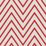Modello con lo zigzag nei colori rossi Immagine Stock