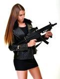 Modello con una pistola Fotografia Stock