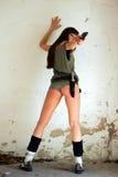 Modello con una pistola Immagini Stock