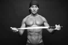Modello con una spada Fotografia Stock