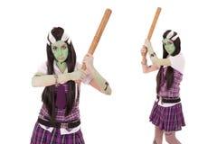 Modello in costume di Frankenstein con la mazza da baseball Fotografie Stock