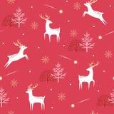 Modello dei cervi di Natale su fondo rosso Immagini Stock Libere da Diritti
