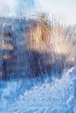 Modello del gelo sulla molla di vetro Fotografia Stock