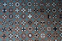 Modello del pavimento con differenti simboli nei cerchi immagini stock