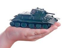 Modello del Plasticine di un serbatoio nella palma del vostro han Fotografia Stock