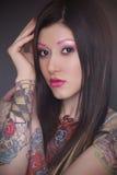 Modello del tatuaggio con trucco luminoso Fotografia Stock Libera da Diritti