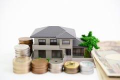 Modello dell'alloggio e dei soldi Fotografia Stock