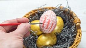 modello dell'uovo in un canestro Fotografia Stock Libera da Diritti