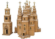 Modello della cattedrale di legno, chiesa, chiesa su un fondo bianco. Un regalo, un ricordo. Immagine Stock