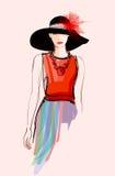 Modello della donna di modo con un black hat Immagine Stock