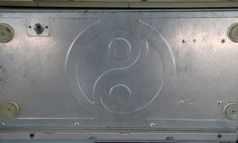 Modello di alluminio del piatto dell'yin yang È la parte della cassa del computer fotografia stock
