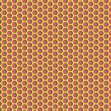 Modello di esagoni - materiale lucido giallo su fondo rosso Immagine Stock