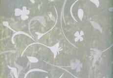 Modello di fiore sul vetro ondulato del fondo Fotografie Stock