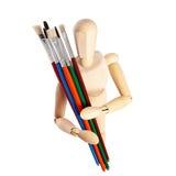 Modello di legno del pittore con i pennelli Fotografie Stock Libere da Diritti