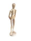 Modello di legno miniatura che si leva in piedi meditatamente Fotografie Stock Libere da Diritti