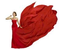 Modello di moda nel tessuto del vestito dalla mosca, panno d'ondeggiamento di bellezza della donna fotografia stock libera da diritti
