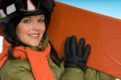 Modello di modo sexy con lo snowboard arancione Fotografia Stock