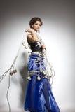 Modello di modo in un costume insolito dei collegare Fotografie Stock