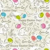 Modello di Pasqua con i conigli, le uova di Pasqua, i fiori ed i pulcini Fotografia Stock