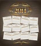 Modello di progettazione - un calendario di 2014 con gli elementi decorati dorati Fotografia Stock