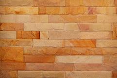 Modello di struttura approssimativa della parete dell'arenaria per fondo immagine stock