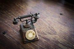 Modello di Telaphone su stile di legno dell'annata del fondo Immagini Stock Libere da Diritti