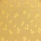 Modello dorato del tessuto del broccato dell'ornamento floreale Fotografie Stock
