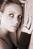 Modello femminile con i branelli Fotografie Stock Libere da Diritti