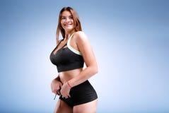 Modello femminile di dimensione più in uno studio Fotografie Stock Libere da Diritti