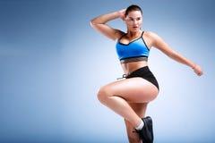Modello femminile di dimensione più in uno studio Fotografia Stock Libera da Diritti