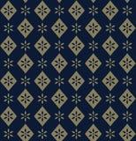 Modello floreale dorato decorativo su fondo blu Fotografie Stock Libere da Diritti