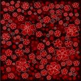 Modello floreale rosso con i fiori allineati e colorati su fondo rosso scuro Fotografia Stock