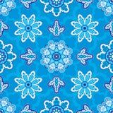 Modello floreale senza cuciture su un fondo blu Fotografie Stock