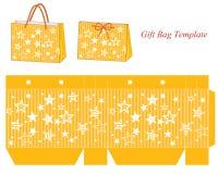 Modello giallo della borsa del regalo con le stelle Fotografia Stock Libera da Diritti