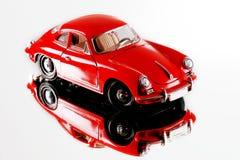 Modello miniatura rosso dell'automobile Fotografie Stock